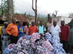 CHURCH-SCHOOL-2-Christians-bring-medicine-clothing-and-food-to-the-christians-and-members-at-Chambellan