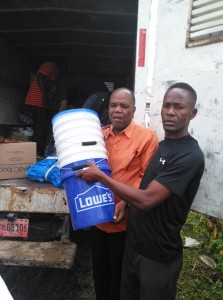 CHURCH-SCHOOL-3-JT-and-Jeriel-getting-buckets-to-connect-water-filters-cholera-is-an-issue