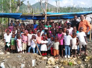 CHURCH-SCHOOL-4-Ecole-Chretienne-de-Chambellan-children-standing-in-shelter-that-was-once-their-school